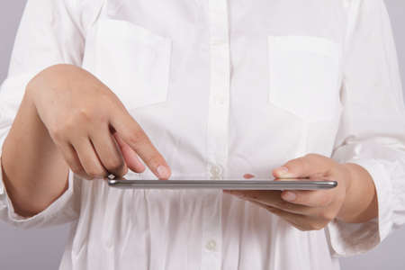 palmtop: woman with tablet computer as business concept