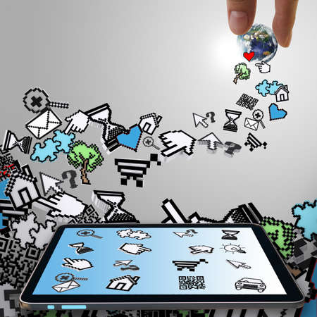 tablet computer with pixel computer icons and hand picks globe Stock Photo - 16097275