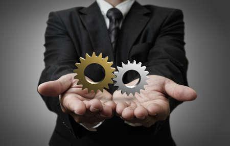 business man hand shows 3d cogs as concept