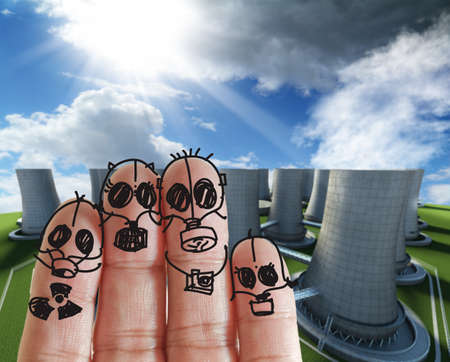 mother earth: fingers family with nuclear power plant