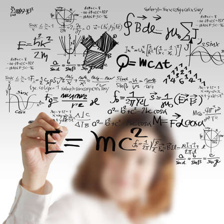 female draws maths and science formula photo