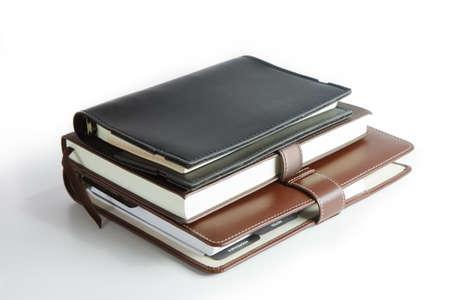 stack van ringband boek of notebook geà ¯ soleerd op wit Stockfoto