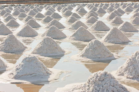 Salt texture with farmer, salt pile in Thailand, salt pan photo