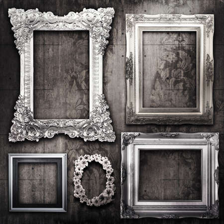 A dark, grungy room with silver frames and Victorian wallpaper