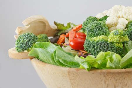 Wooden bowl of mixed salad