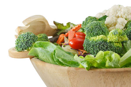 Wooden bowl of mixed salad on white