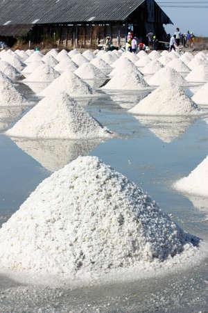 Salt texture with farmer, salt pile in Thailand, salt pan