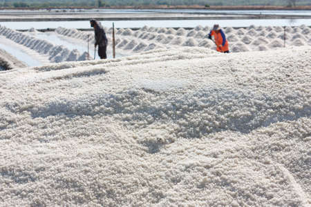 Salt texture with farmer, salt pile in Thailand, salt pan