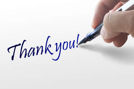 mannerism: Hand writes the word thank you Stock Photo