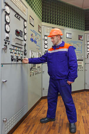 experienced operator: Engineer starts the turbine on main control panel of gas compressor station