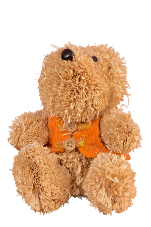 Straw man in the form of a bear with button eyes and an orange vest