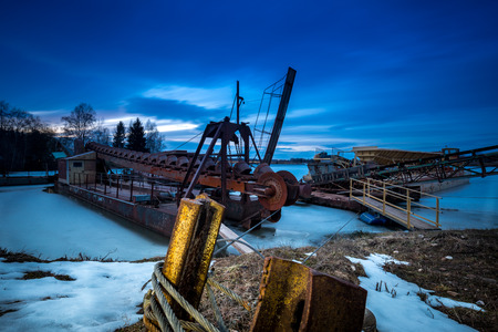 dredging: Dredging in the winter position on a frozen lake.