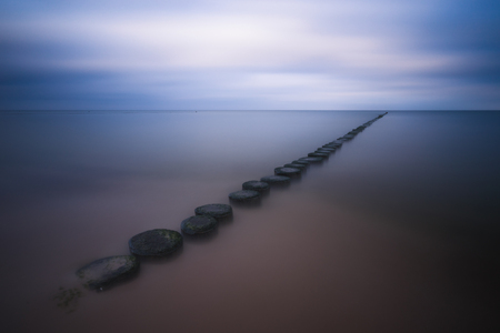 Groynes for coastal protection by the sea, taken with a long exposure. Reklamní fotografie