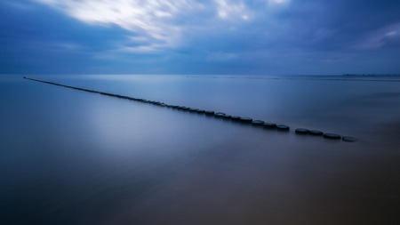 Groynes for coastal protection on the Baltic Sea, taken with a long exposure.