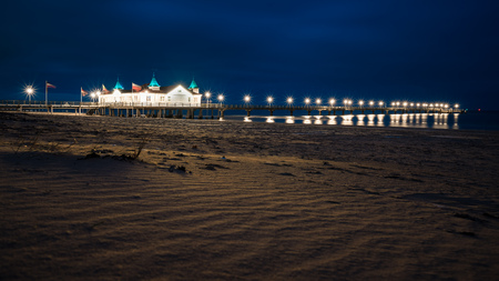 The historic pier of Ahlbeck on the sunny island of Usedom, recorded in the evening with a long exposure.