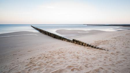 Wood groynes on the Baltic Sea, coastal protection on the island of Usedom.