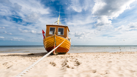 Small fishing boat on the Baltic Sea beach on the island of Usedom, on a beautiful sunny day. Reklamní fotografie