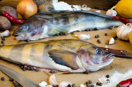 greenling: grinling fish potatoes onions garlic lemon pepper on baking paper
