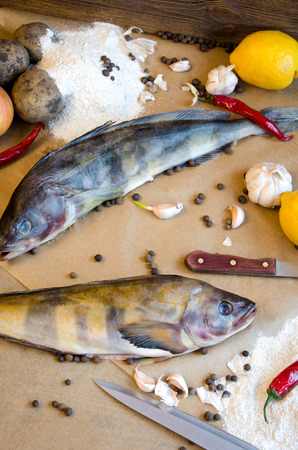 greenling: grinling fish with vegetables garlic lemon pepper on baking paper