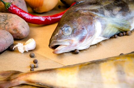 grinling fish with vegetables on baking paper closeup Stock Photo