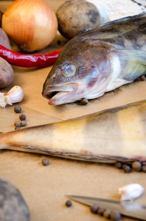 grinling fish vegetables lemon pepper on baking paper closeup