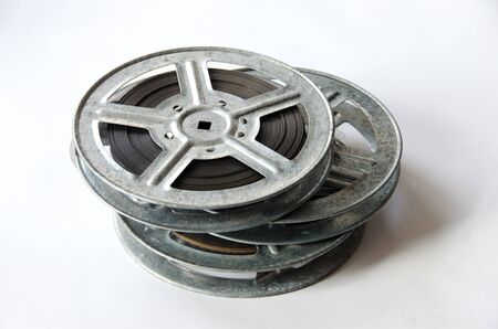 16mm: three film reels cinematography with cinema accessories on white background Stock Photo