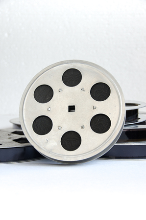 16mm: one film reel closeup on a white background Stock Photo