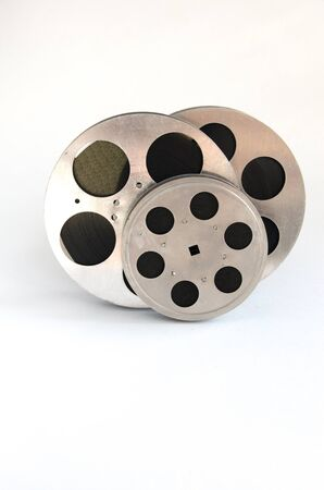 16mm: three aluminum film reels on a white background