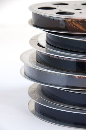 16mm: stack of old motion picture film reel on a white background