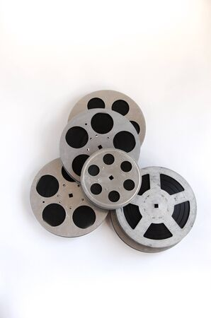cine: pile of film reels on a white background top view