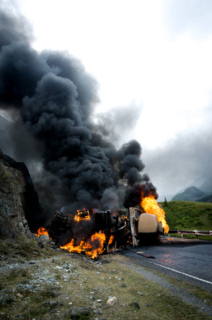 Burning gas tank truck road accident on the track selective focus Stock Photo
