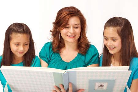 photo album: Mother showing daughters photo album