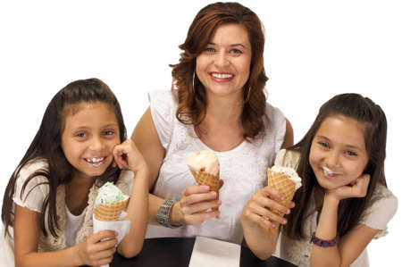 woman with ice cream: Mother and daughters eating ice cream Stock Photo