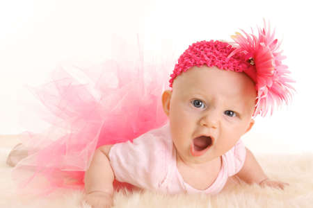 Cute young infant girl in a pink tutu and head band with an angry game face Stock Photo - 5445333