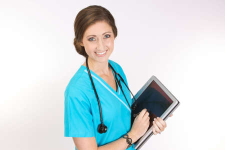 Attractive young nurse working with software on a tablet pc versus manual clipboard