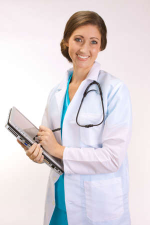 Young attractive female doctor using a tablet PC instead of manual clipboard Stock Photo - 5581938