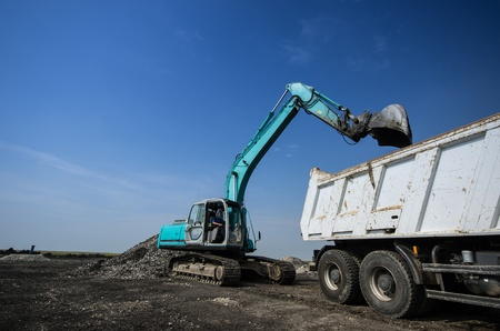 Dredger loading truck on the site photo