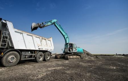 dredger: Dredger loading truck on the site