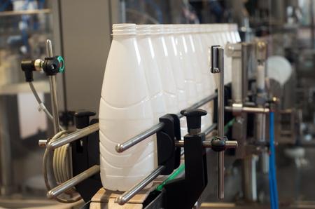 conveyor belts: Plastic bottles of milk on the conveyor belt