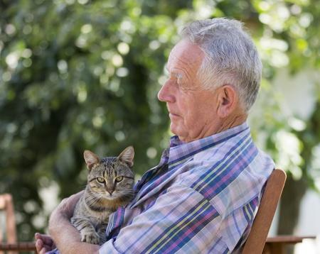 Senior man with cat photo