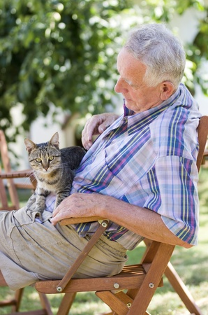 Senior man with cat Stock Photo