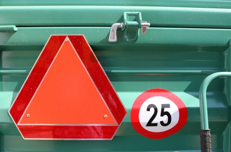 tractor warning sign: Speed limit and worning sign on back of truck Stock Photo