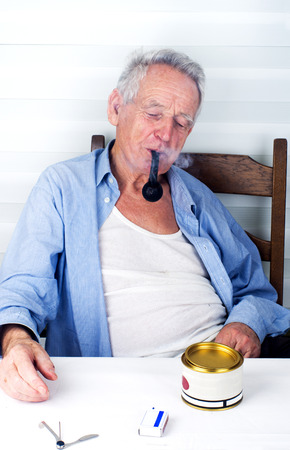 Old man bohemian enjoying smoking pipe  photo