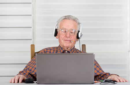 meditative: Senior man with headphones and eyes closed listen meditative music