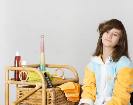 bangs: Girl with curled bangs and bathroom accessories  Stock Photo