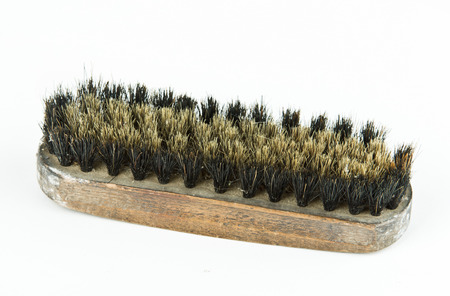 Old brush for clothes isolated on white  photo