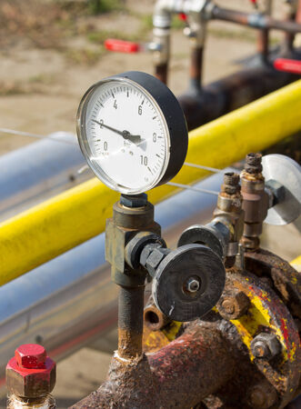 Close up of barometer in natural gas production industry photo