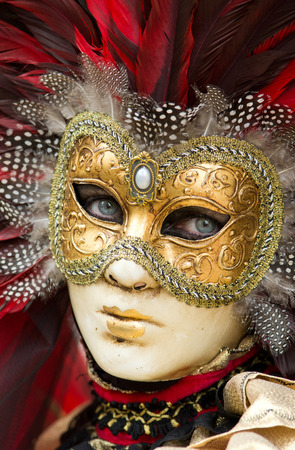 Girl with blue eyes with traditional carnival mask in Venice photo