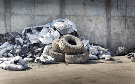 dump yard: Pile of old used tires and rubber garbage for recycling Stock Photo