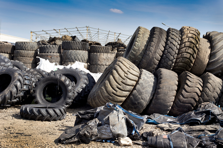 stocked: Bunch of old used tires stocked for recycling